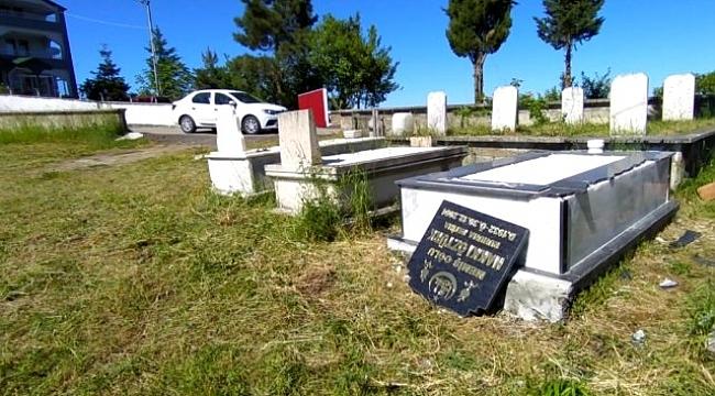 Mezarları parçalayan şahıs kameraya yakalandı